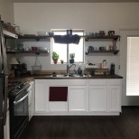Jeff made the shelves and installed the countertop!